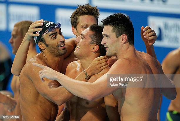 Filippo Magnini Marco Orsi Michele Santucci and Luca Dotto of Italy celebrate after winning the Bronze medal in the Men's 4x100m Freestyle Relay on...