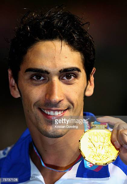 Filippo Magnini of Italy poses with his gold medal following a joint victory in the Men's 100m Freestyle Final during the XII FINA World...
