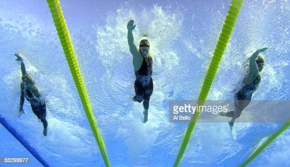 Filippo Magnini of Italy Roland Schoeman of South Africa and Ryk Neethling of South Africa swim in the 100 meter Freestyle final at the XI FINA World...