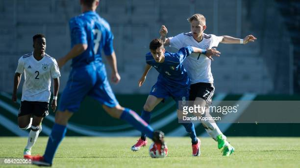 Filippo Melegoni of Italy is challenged by Arne Maier of Germany during the U18 International Friendly match between Germany and Italy on May 17 2017...