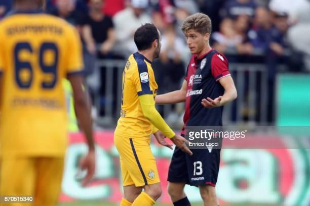 Filippo Romagna of Cagliari and Giampaolo Pazzini of Verona reacts during the Serie A match between Cagliari Calcio and Hellas Verona FC at Stadio...