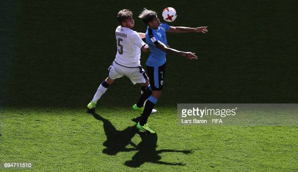 Filippo Romagna of Italy challenges Joaquin Ardaiz of Uruguay during the FIFA U20 World Cup Korea Republic 2017 3rd rank playoff match between...