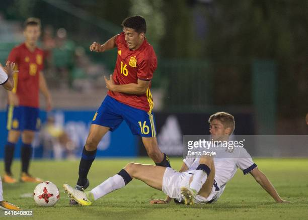 Filippo Romagna of Italy tries to take the ball from Pablo Fornals of Spain during the Italy v Spain Under21 Friendly match at Estadio Municipal...