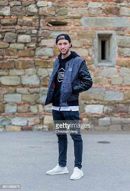 Filippo Santambrogio is wearing a grey college jacket grey pants cap white sneaker on January 12 2017 in Florence Italy