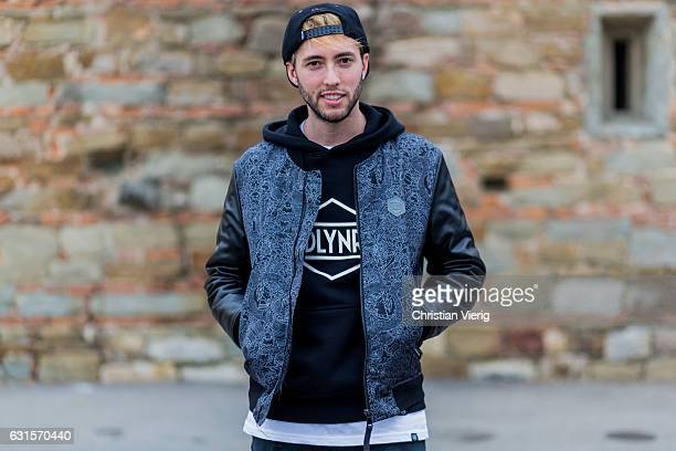 Filippo Santambrogio is wearing a grey college jacket grey pants on January 12 2017 in Florence Italy