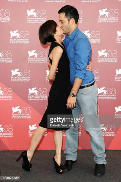 Filippo Timi and Claudia Pandolfi kiss at the 'Quando la notte' Photocall during the 68th Venice International Film Festival at Palazzo del Casino on...