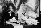 Filippo Tommaso Marinetti Italian poet writer and dramatist sitting at a desk with some Futurist magazines