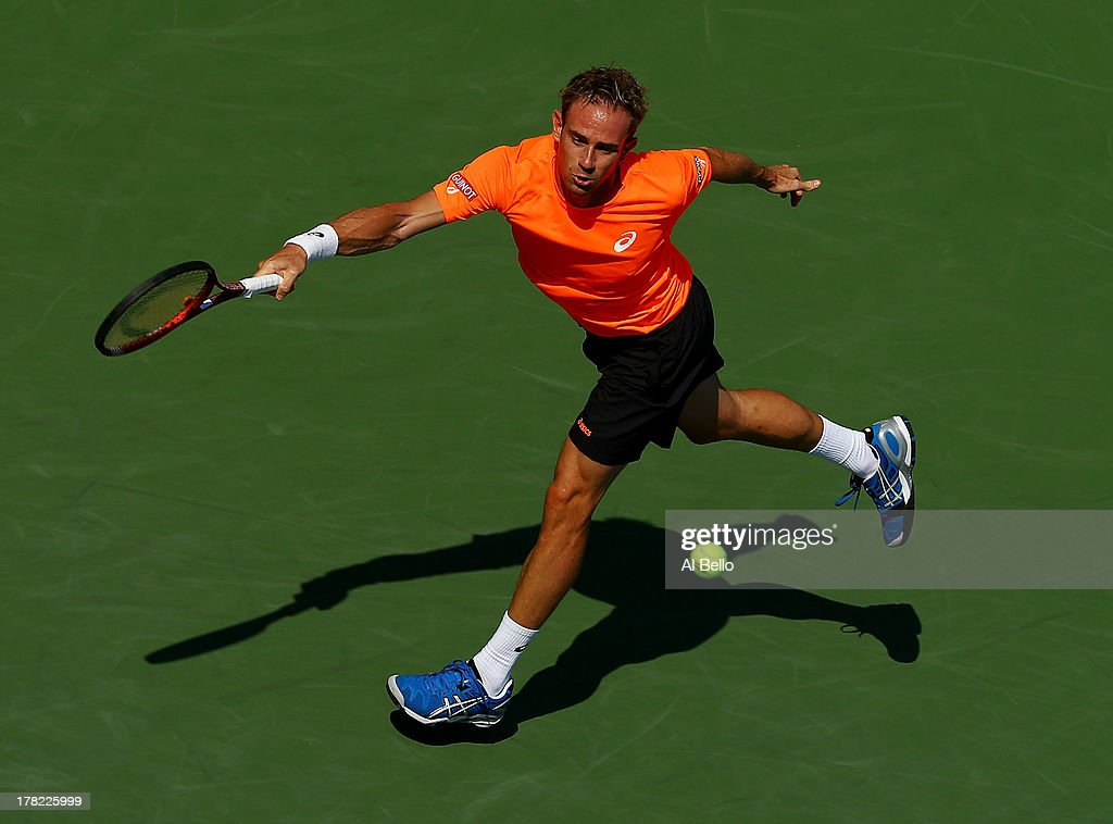 <a gi-track='captionPersonalityLinkClicked' href=/galleries/search?phrase=Filippo+Volandri&family=editorial&specificpeople=220545 ng-click='$event.stopPropagation()'>Filippo Volandri</a> of Italy returns a shot to John Isner of United States of America during their first round men's singles match on Day Two of the 2013 US Open at USTA Billie Jean King National Tennis Center on August 27, 2013 in the Flushing neighborhood of the Queens borough of New York City.