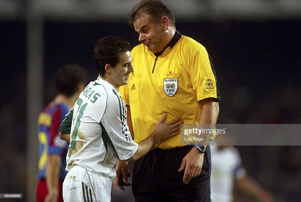 Filippos Darlas of Panathinaikos shares a laugh with referee Rene Temmink during the UEFA Champions League group C match between FC Barcelona and Panathinaikos at the Camp Nou stadium on November 2, 2005 in in Barcelona, Spain.