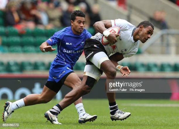 Fili's Semi Kunatani is challenged by Samoa's Fale So'oialo during day two of the Marriott London Sevens at Twickenham Stadium London