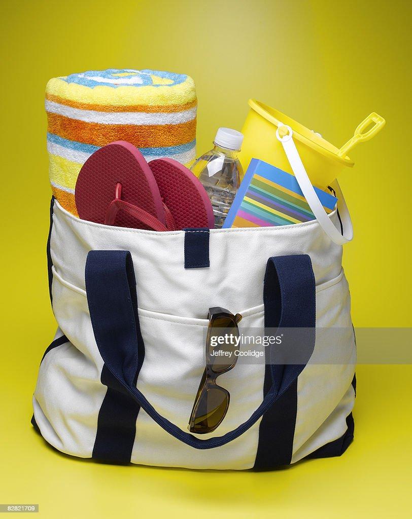 Filled beach bag : Stock Photo