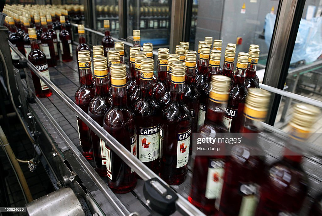 Filled bottles of Campari travel along the production line ahead of packaging at Davide Campari-Milano SpA's factory in Novi Ligure, Italy, on Wednesday, Nov. 21, 2012. Business conditions in Italy, where Campari gets almost a third of annual revenue, are likely to remain volatile in the fourth quarter and early next year, Chief Executive Officer Bob Kunze-Concewitz said. Photographer: Alessia Pierdomenico/Bloomberg via Getty Images