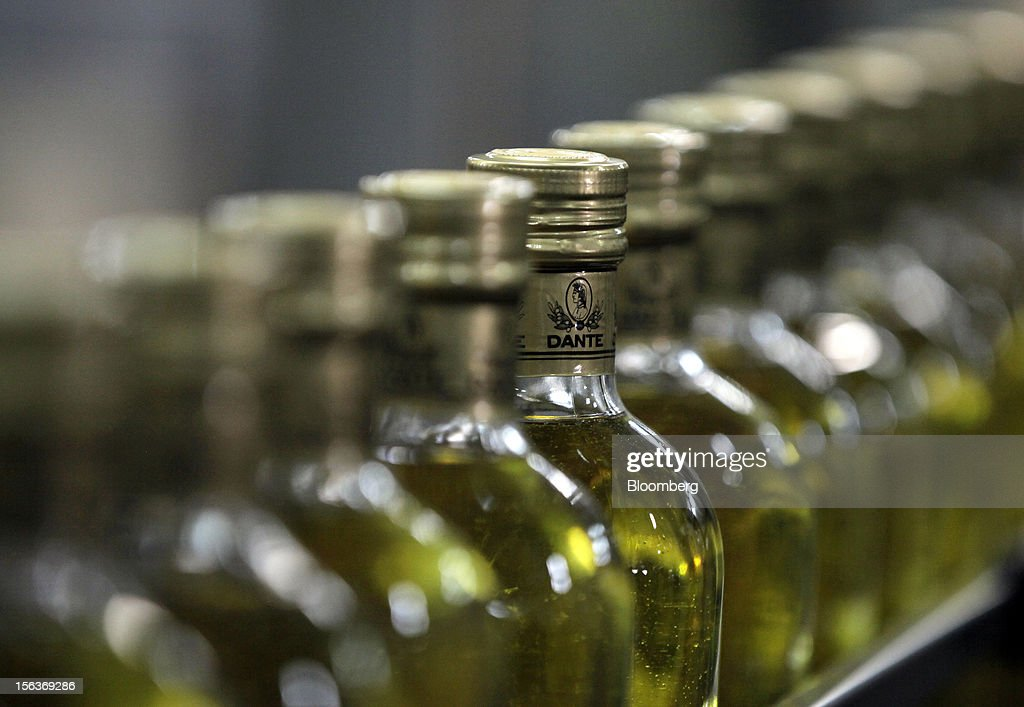 Filled bottles of Dante olive oil travel along the production line at Industria Olearia Biagio Mataluni Srl's factory in Montesarchio near Benevento, Italy, on Monday, Nov. 12, 2012. Italian olive-oil exports rose 5.7 percent to a record last year, boosted by demand from the U.S. as well as France and Germany, agricultural-markets researcher Ismea said. Photographer: Alessia Pierdomenico/Bloomberg via Getty Images