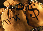 Filled sacks with the initials WWW and $ chained and locked