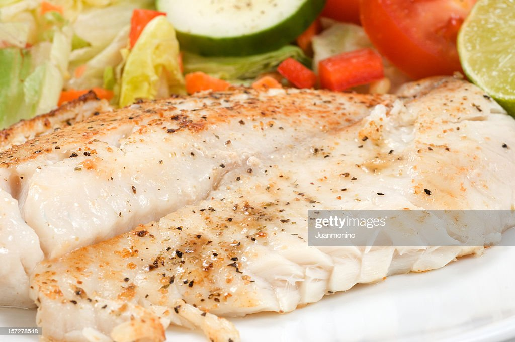 Fillet of fish and salad stock photo getty images for Fish and salad