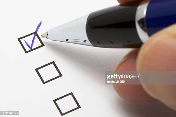 Filling a check box with a blue ballpoint pen