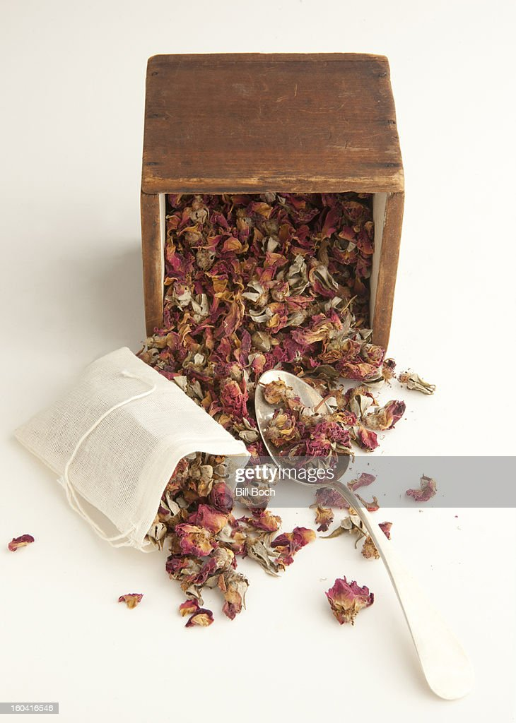 Filling a dried roses potpourri sachet bag : Stock Photo