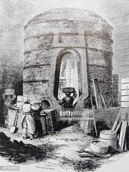 Filling a kiln ready for firing Copeland's factory Stoke on Trent Staffordshire England Engraving London c1860