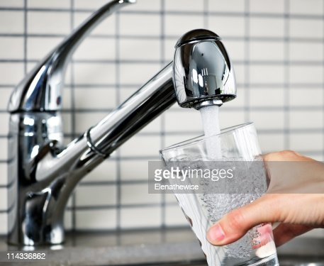 Filling glass of tap water : Stock Photo