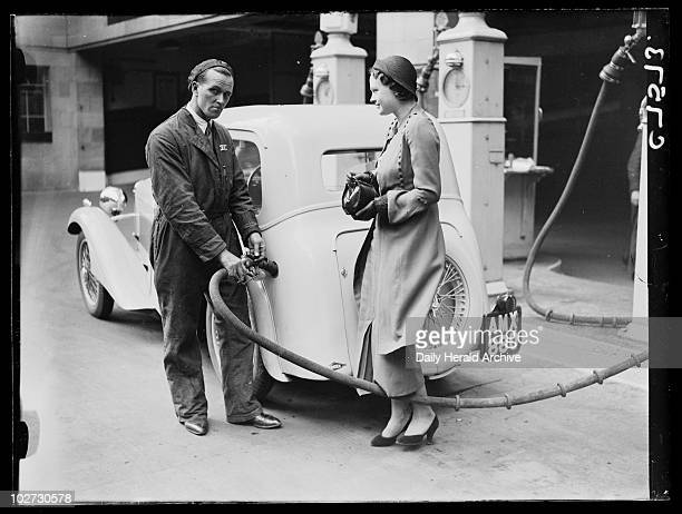 Filling up with petrol 17 April 1934 Photograph of a woman having her car filled up with petrol at a garage taken by Edward Malindine for the Daily...