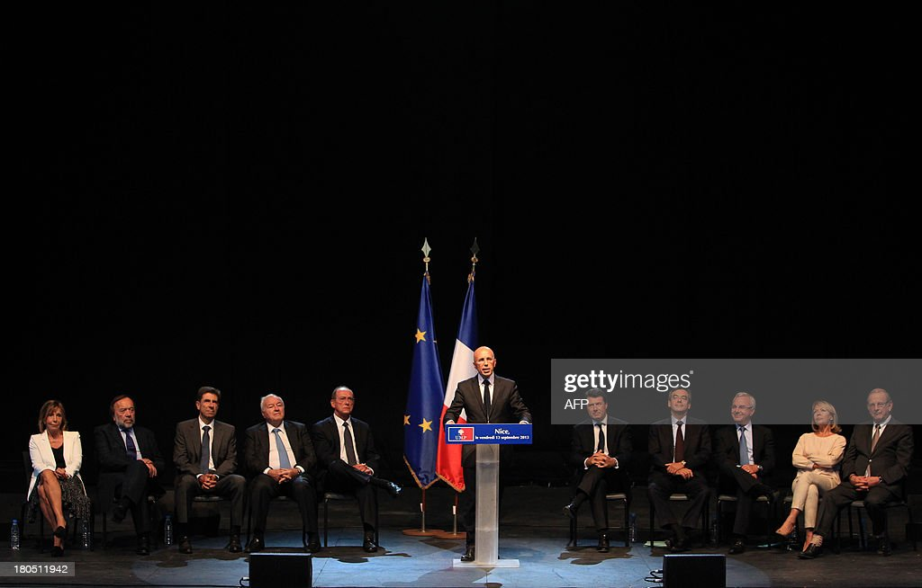 Fillon's former campaign director, Eric Ciotti, delivers a speech with (from L to R) UMP senator Hélène Masson-Maret, UMP european deputy Gaston Franco, UMP deputy Charles-Ange Ginesy, Cannes' mayor Bernard Brochand, UMP senator Jean-Pierre Leleux, Nice's mayor Christian Estrosi, French former Prime minister and UMP right-wing party member Francois Fillon, Antibes' mayor Jean Leonetti, UMP senator Colette Giudicelli, and Menton's mayor Jean-Claude Guibal, during a meeting, on September, 13, 2013, in Nice, southeastern France.