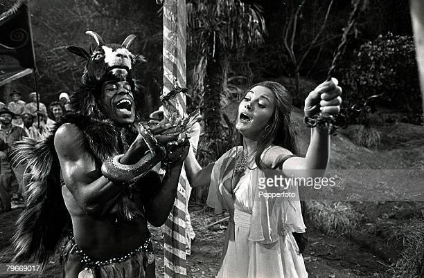 Film Actor Jane Seymour is menaced by a voodoo worshipper with a snake in a scene from the James Bond film 'live and let die' at Pinewood Studios...