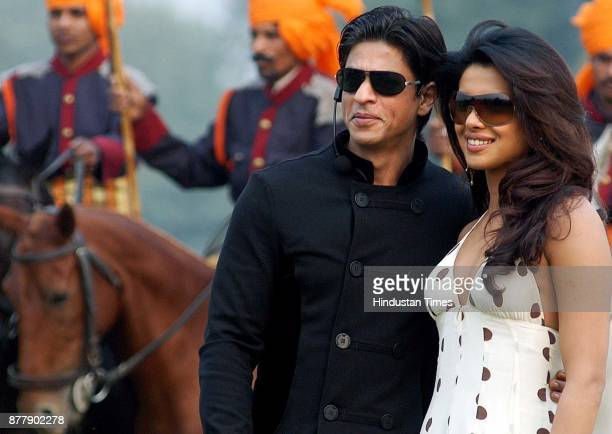 Film actor Shahrukh Khan and Priyanka Chopra poses for photographers at the Jaipur polo ground in New Delhi on Sunday