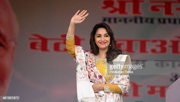Film actress and brand ambassador Madhuri Dixit waved to the crowd at launch of Beti Bachao Beti Padhao programme on January 22 2015 in Panipat India...