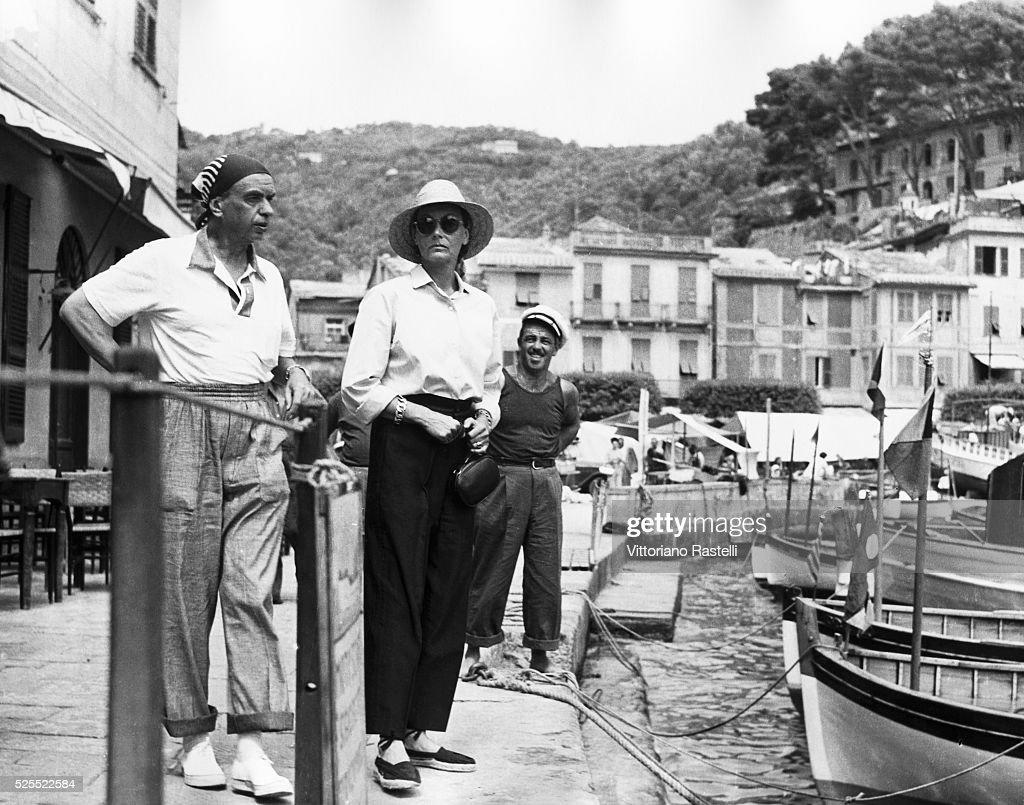 Film actress Greta Garbo strolling with a friend along the sea front in Portofino Italy