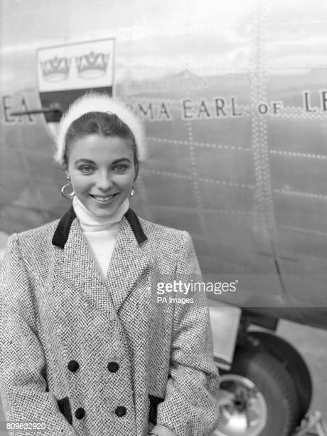 Film actress Joan Collins at London Airport as she was about to leave in a BEA Elizabethan liner for Barcelona on her way to Majorca for location...