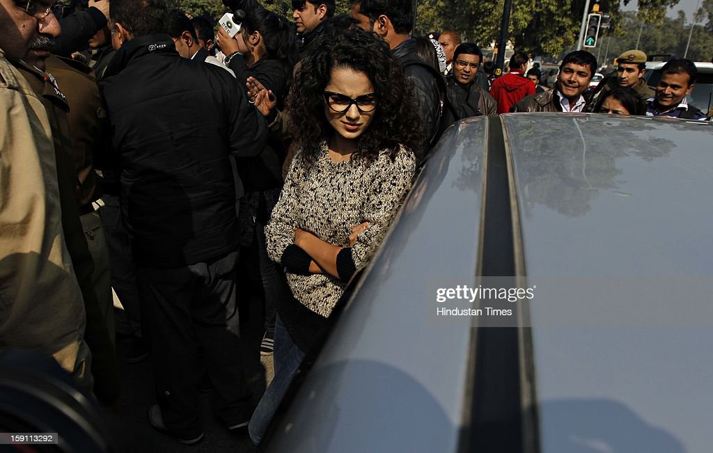 Film actress Kangna Ranaut campaign for safety of women on roads by not having tinted glasses on vehicle at India Gate on January 8, 2013 in New Delhi, India.