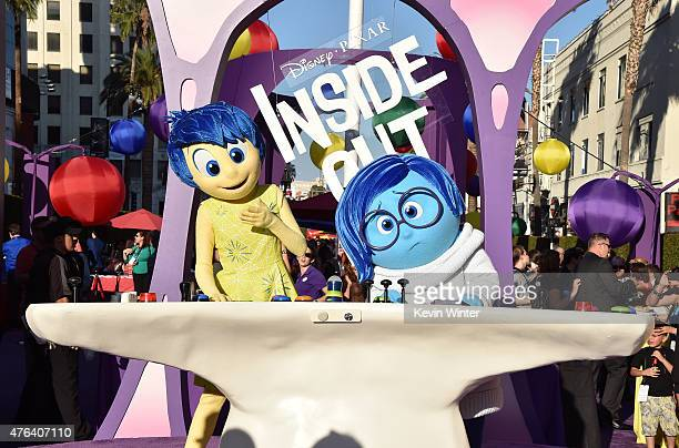 Film characters Joy and Sadness attend the Los Angeles premiere of DisneyPixar's 'Inside Out' at the El Capitan Theatre on June 8 2015 in Hollywood...