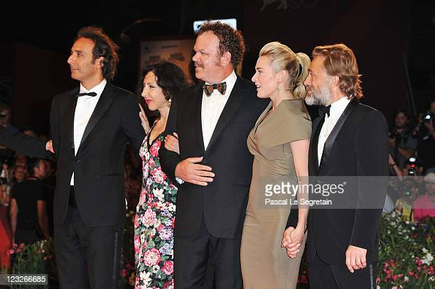 Film Composer Alexandre Desplat writer Yasmina Reza actors John C Reilly Kate Winslet and Christoph Waltz attend the 'Carnage' premiere at the...