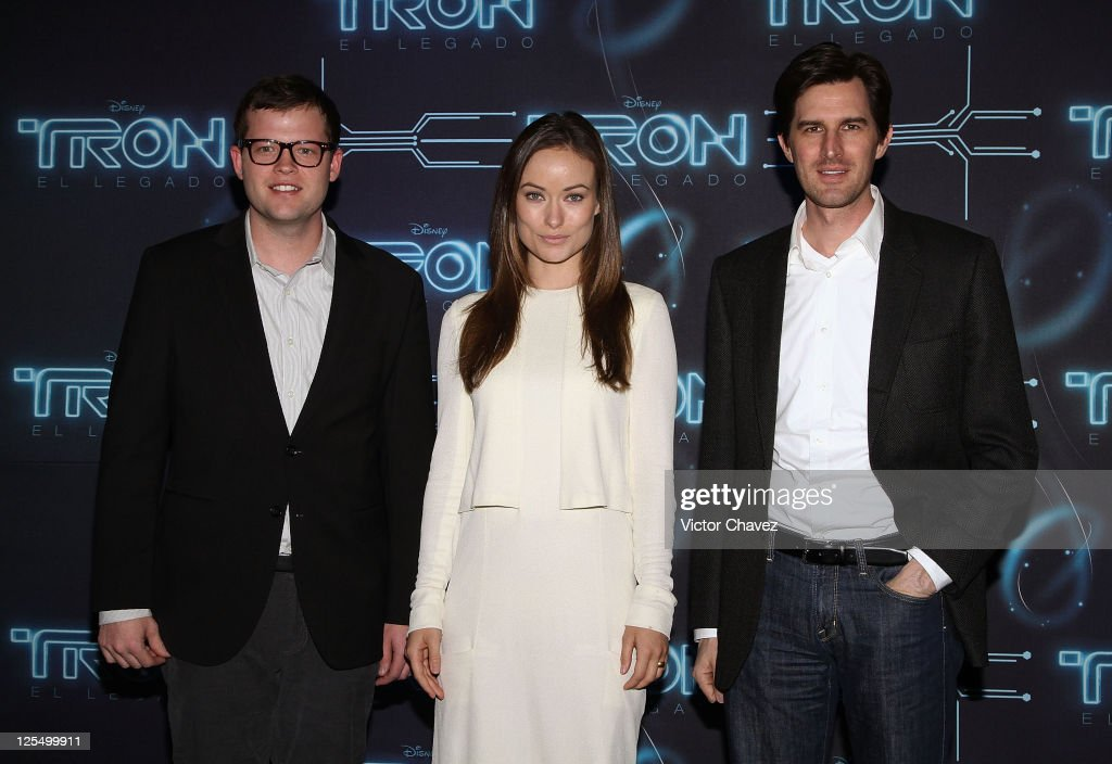 Film Co-producer Justin Spencer, actress <a gi-track='captionPersonalityLinkClicked' href=/galleries/search?phrase=Olivia+Wilde&family=editorial&specificpeople=235399 ng-click='$event.stopPropagation()'>Olivia Wilde</a> and Film director <a gi-track='captionPersonalityLinkClicked' href=/galleries/search?phrase=Joseph+Kosinski&family=editorial&specificpeople=7113921 ng-click='$event.stopPropagation()'>Joseph Kosinski</a> attend a photocall to promote the film 'TRON: Legacy' at St. Regis Hotel on December 8, 2010 in Mexico City, Mexico.