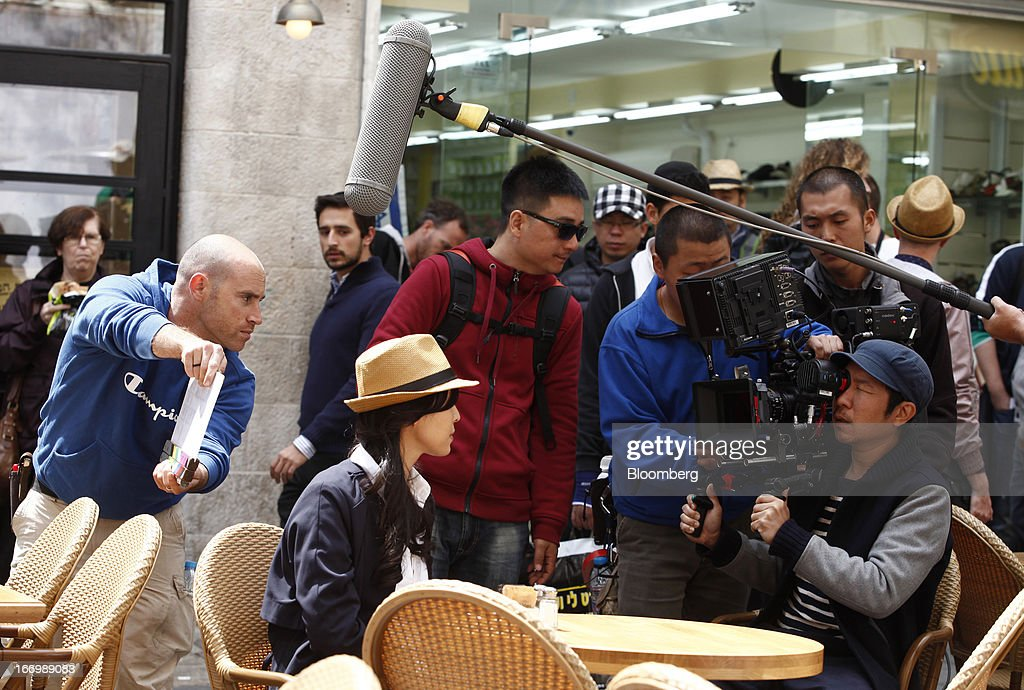 A film crew from Chuan Films shoots footage of Zhang Jingchu, a Chinese actress, center, on the set of 'The Old Cinderella' at the Ben Yehuda pedestrian mall in Jerusalem, Israel, on Friday, April 19, 2013. The Bank of Israel governor said Europe remains the weak link in the world economy and European Union officials need to tackle the continent's banking difficulties. Photographer: Ariel Jerozolimski/Bloomberg via Getty Images *** Zhang Jingchu