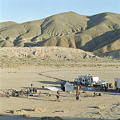 Film crew on location in desert, elevated view