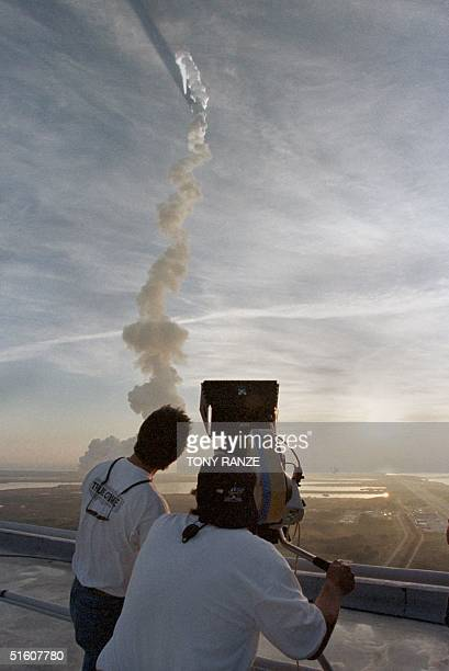 A film crew shooting a new movie 'Space Cowboys' directed by Clint Eastwood follows the trail of smoke left by the space shuttle Discovery as it...