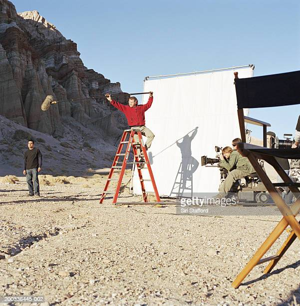 Film crew shooting in desert