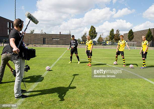 A film crew video Marcel Schmelzer DongWon Ji and Oliver Kirch in action during the Borussia Dortmund team presentation on August 11 2014 in Dortmund...