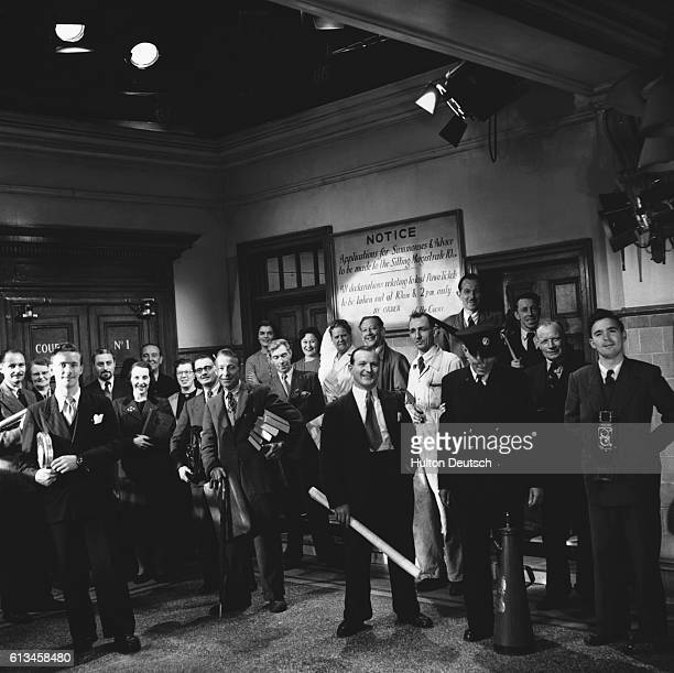 Film crews behind the scenes at a court room scene ready for filming at the Ealing Studios 1951 has been a memorable year for Ealing Studios It was...