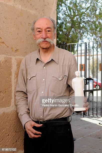 Film critic Jorge Ayala Blanco poses with his Joaquín Rodríguez Journalistic Merit Award granted by the Mexican Network of Film Journalists during...