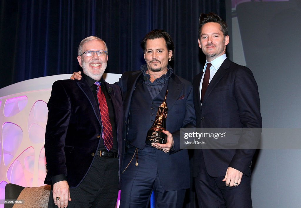 Film Critic Leonard Maltin ActorJohnny Depp and Director Scott Cooper onstage at the Maltin Modern Master award tribute during the 31st Santa Barbara...