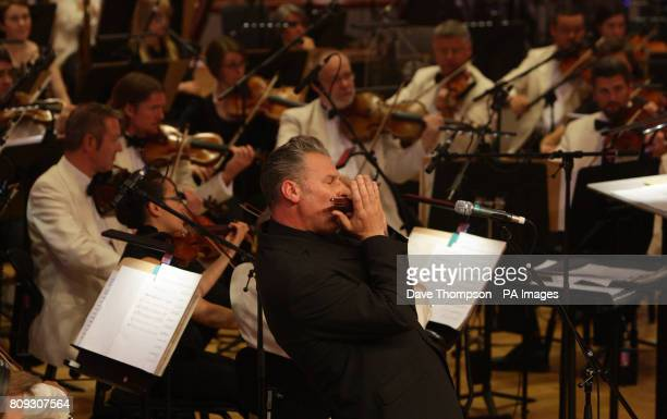 Film critic Mark Kermode plays the harmonica with the BBC Philharmonic orchestra at MediaCityUK in Salford for the film review show on BBC Radio 5...