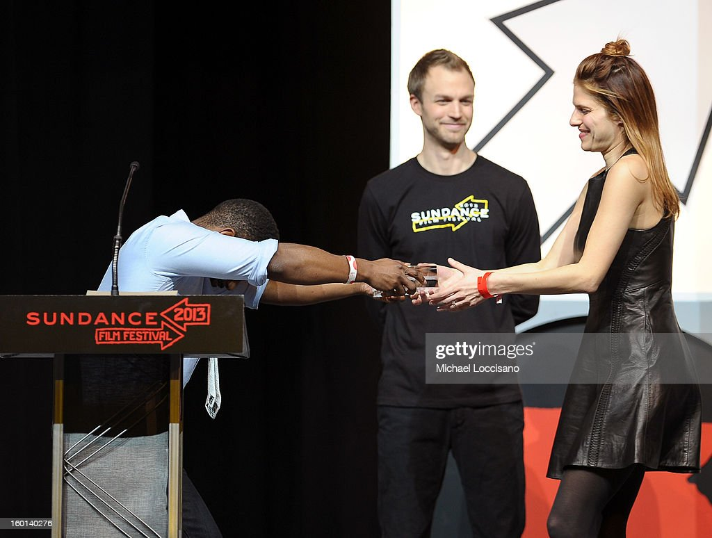 Film critic Wesley Morris (L) presents the Waldo Salt Screenwriting Award for US Dramatic to Lake Bell (R) at the Awards Night Ceremony during the 2013 Sundance Film Festival at Basin Recreation Field House on January 26, 2013 in Park City, Utah.