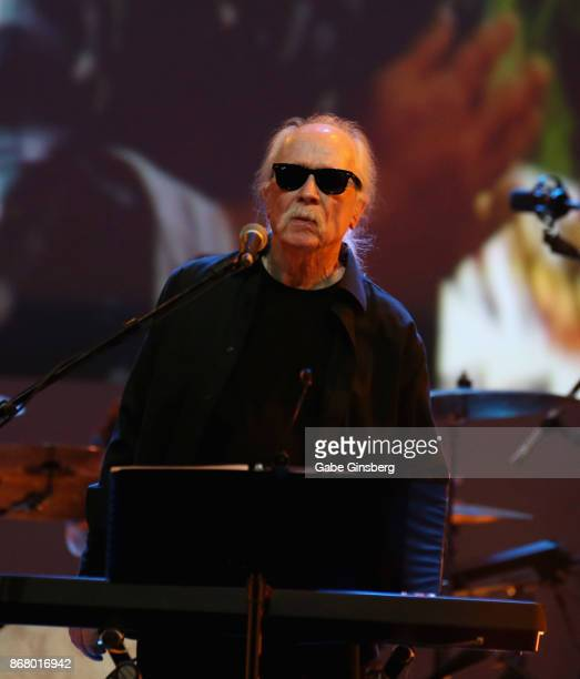 Film director and composer John Carpenter performs with scenes from the movie 'They Live' playing as he kicks off his tour at The Joint inside the...