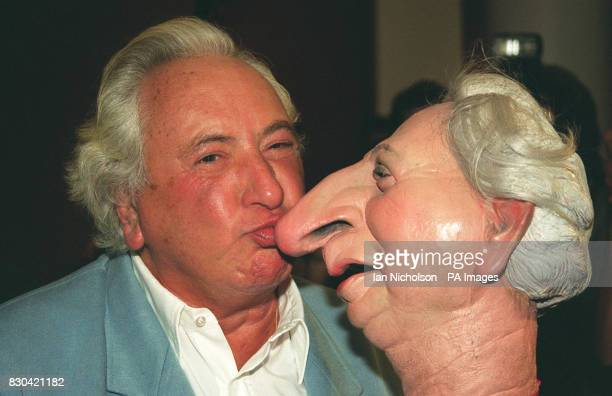 Film director and restaurant critic Michael Winner was reunited with his puppet at a celebrity farewell party for the old tv series at Sothebys in...