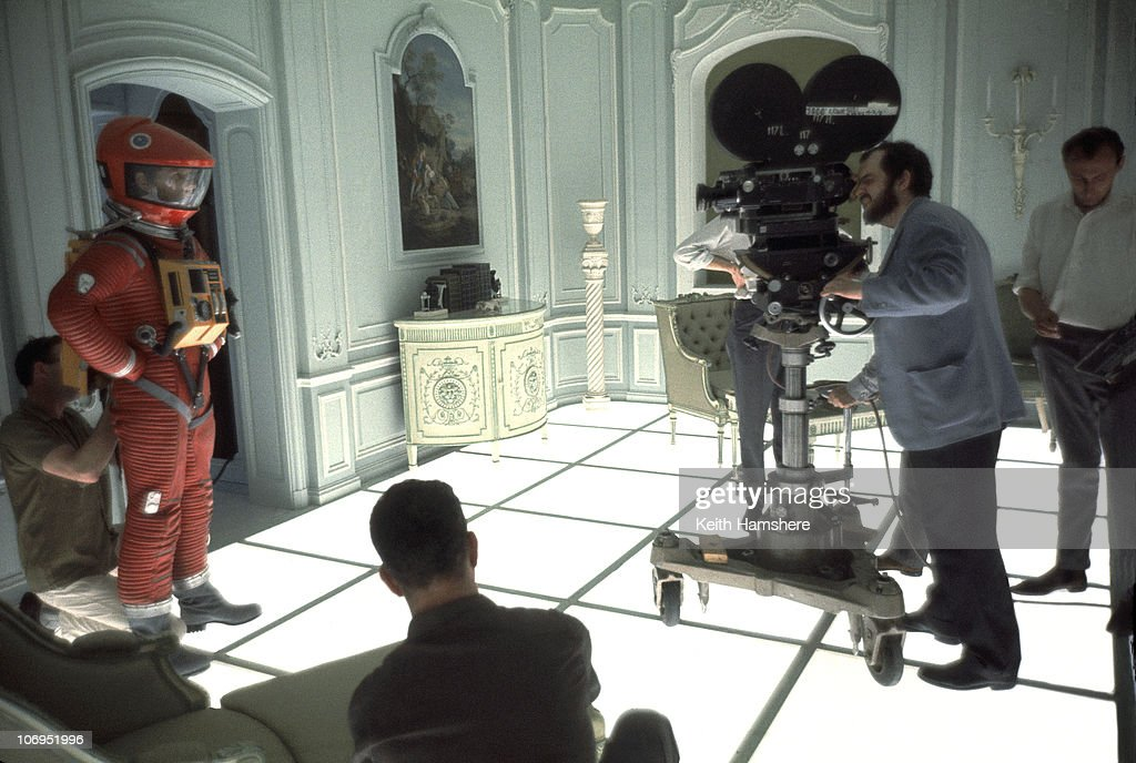 Film director and screenwriter Stanley Kubrick (1928 - 1999) finds his shot on the set of '2001: A Space Odyssey' at the MGM British Studios in Borehamwood, Hertfordshire, 1966. On the left is American actor Keir Dullea in a spacesuit.