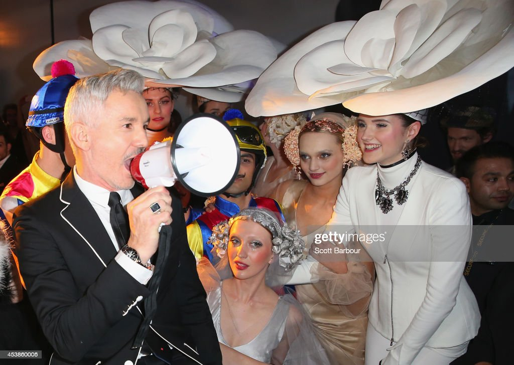 Film director <a gi-track='captionPersonalityLinkClicked' href=/galleries/search?phrase=Baz+Luhrmann&family=editorial&specificpeople=209230 ng-click='$event.stopPropagation()'>Baz Luhrmann</a> poses with models as he attends the launch of Emporium Melbourne on August 20, 2014 in Melbourne, Australia.