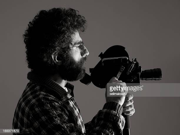 Film director behind camera