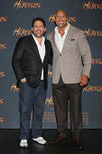 Film Director Brett Ratner and Actor Dwayne Johnson attend the photocall for 'Hercules' at St Regis Hotel on August 18 2014 in Mexico City Mexico